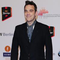 Robbie Williams scrie piese pentru noul album solo