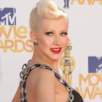 Christina Aguilera, aparitie socanta la inmormantarea Ettei James