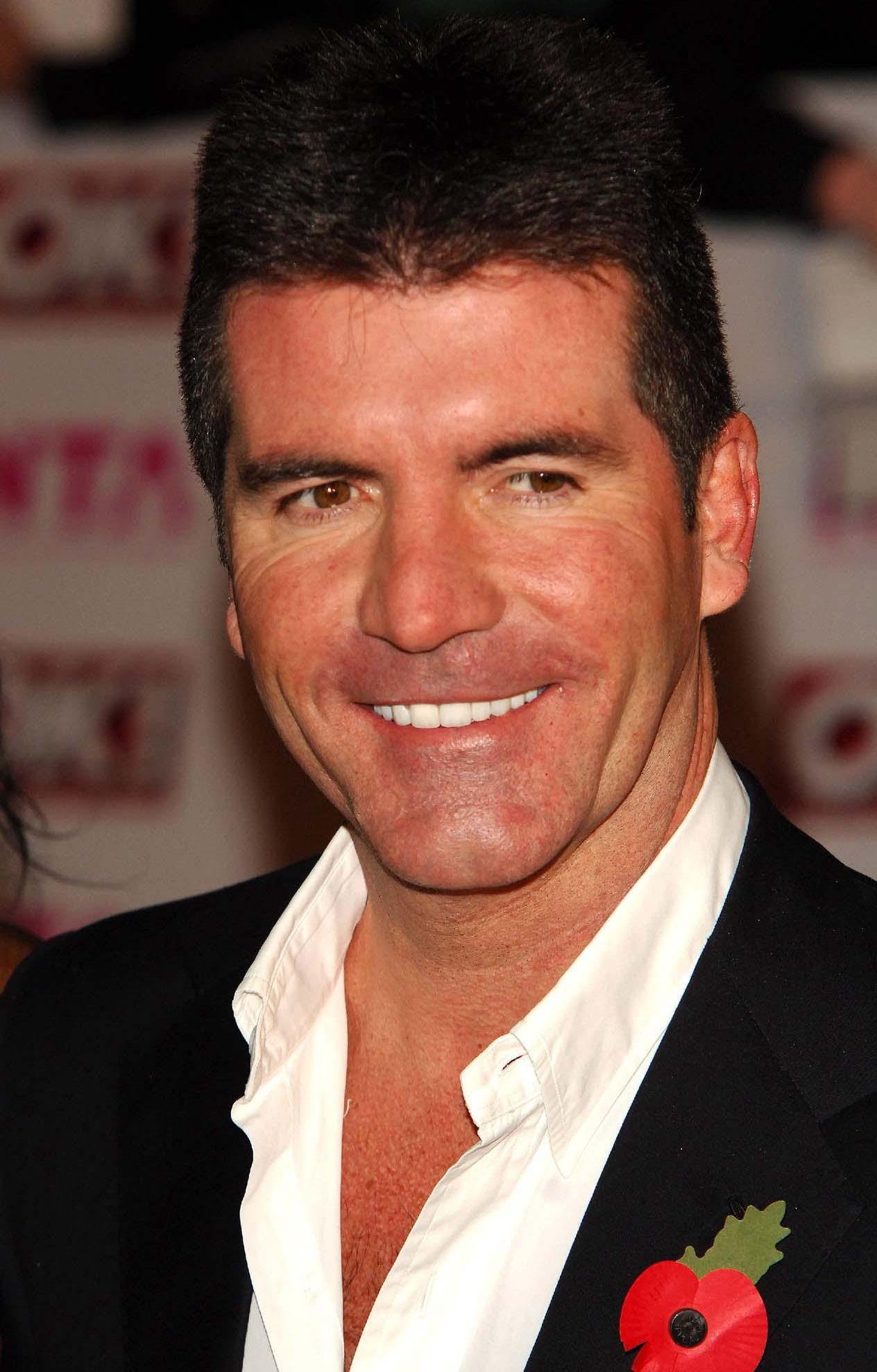 Simon Cowell si-a angajat antrenor personal